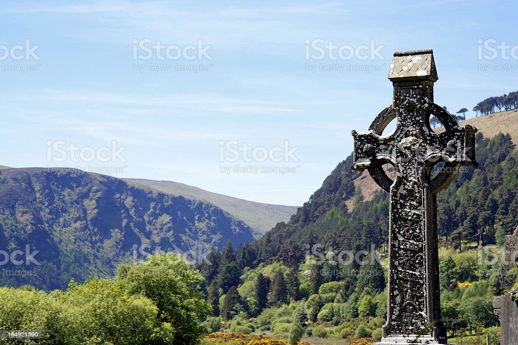 Irish high cross and landscape royalty-free stock photo