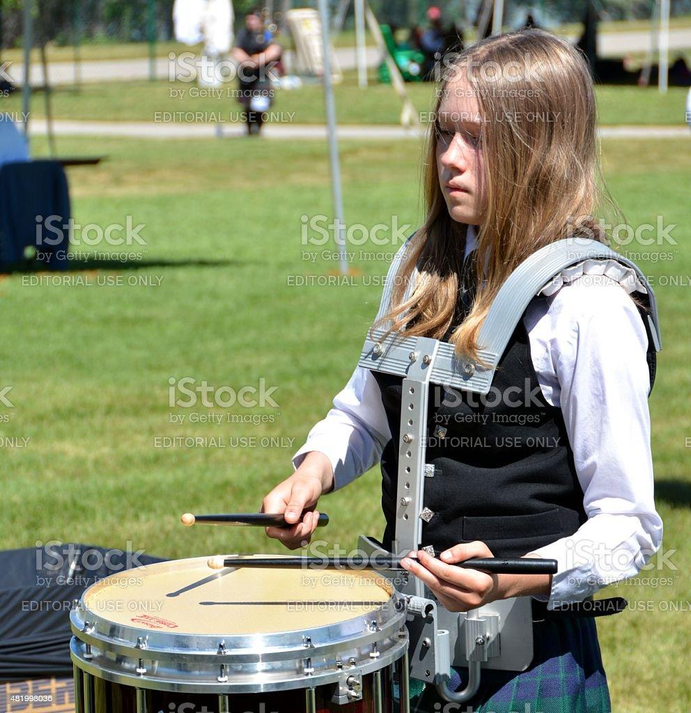 Irish Lass playing the Snare Drum stock photo