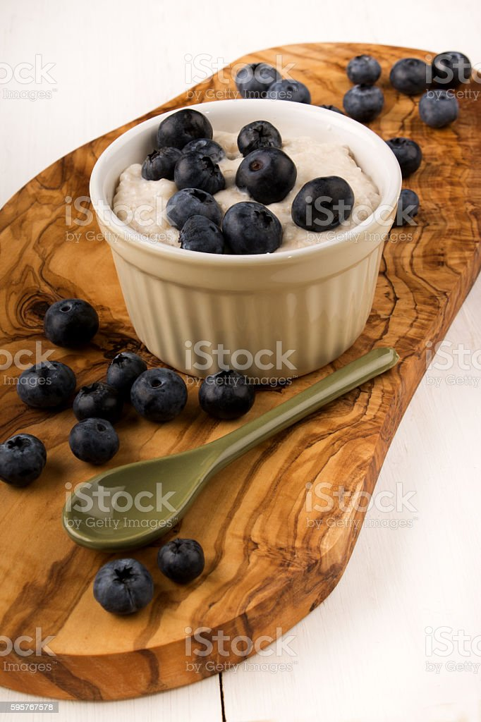 irish oatmeal boiled with milk and blueberries stock photo