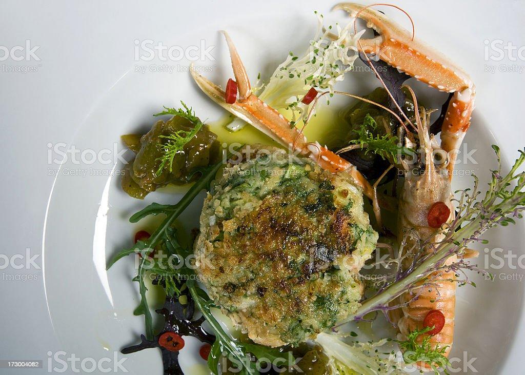 Irish oatmeal coated fish cakes with langoustine royalty-free stock photo