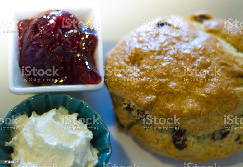 Irish Raisin Tea Scone with Jam and Butter stock photo