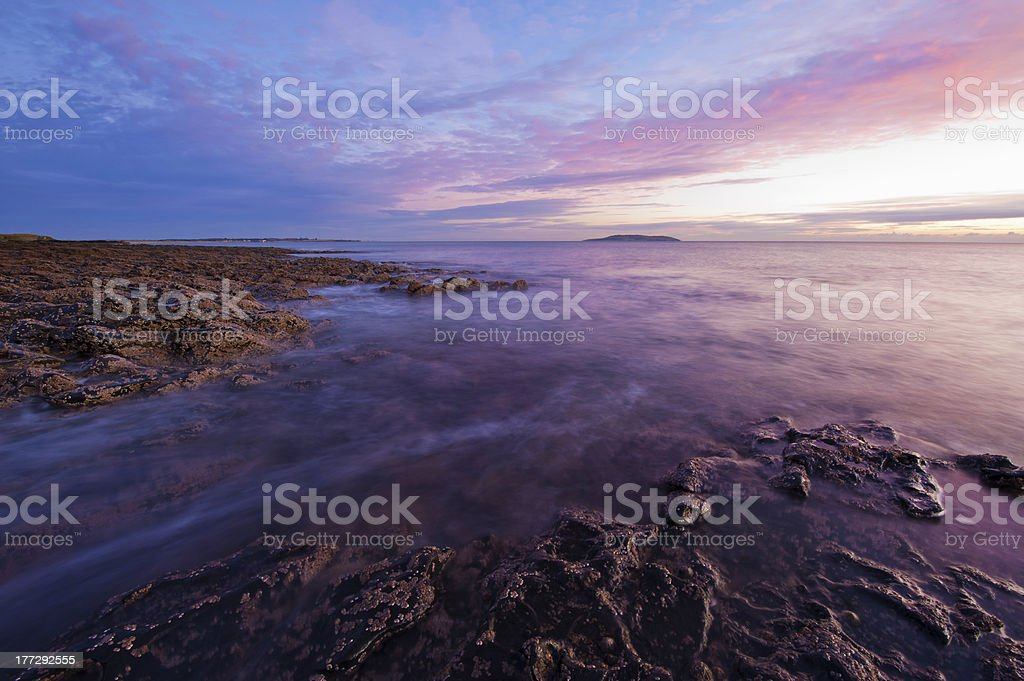 Irish shore at sunrise royalty-free stock photo