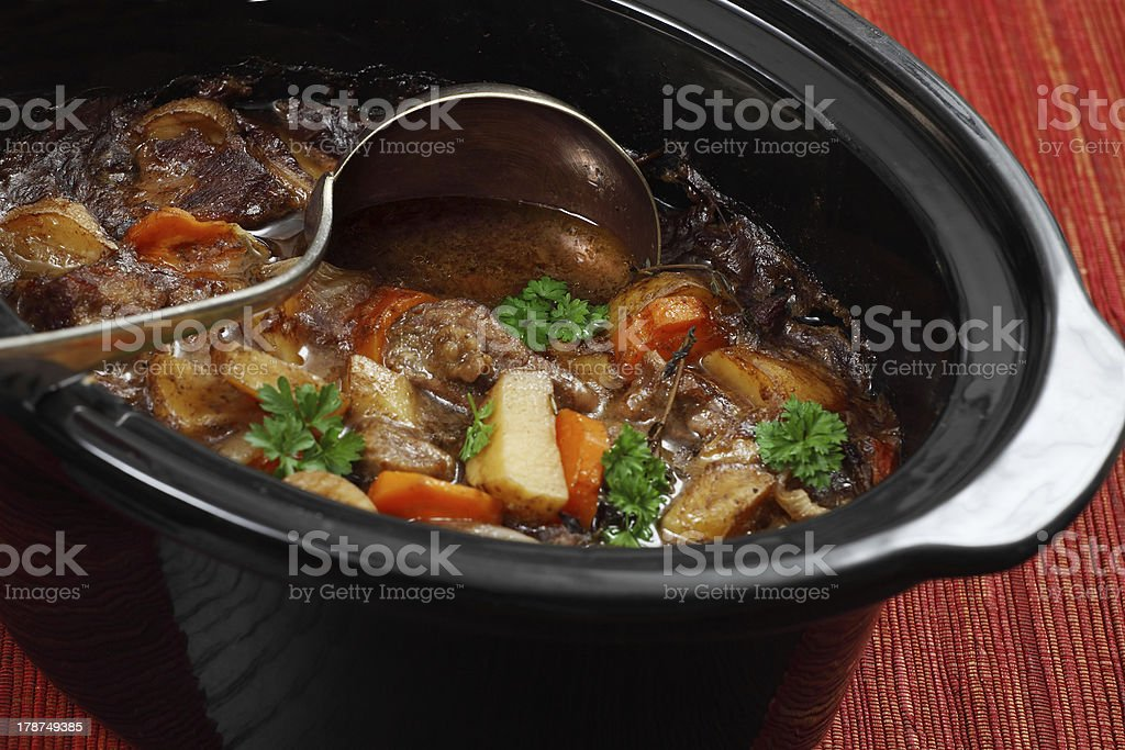 Irish stew in a slow cooker pot stock photo