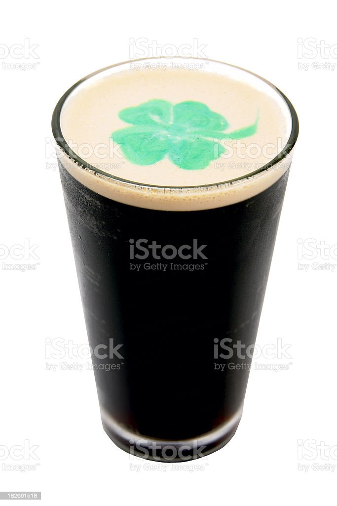 Irish Stout Beer with Green Shamrock royalty-free stock photo
