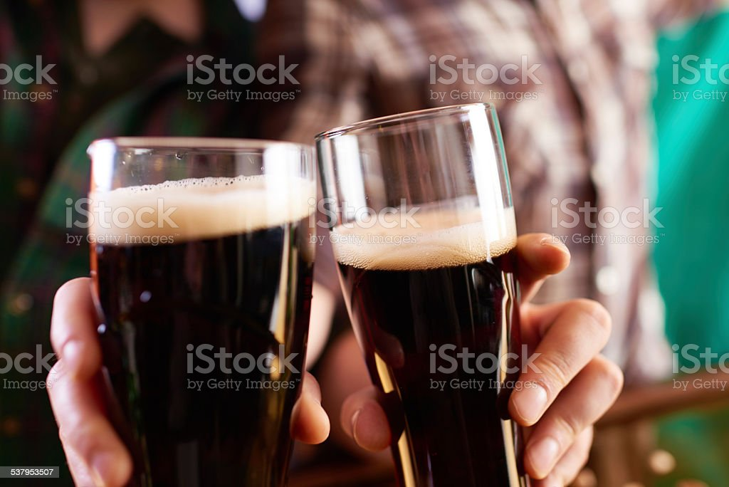 Irish stout cheers stock photo