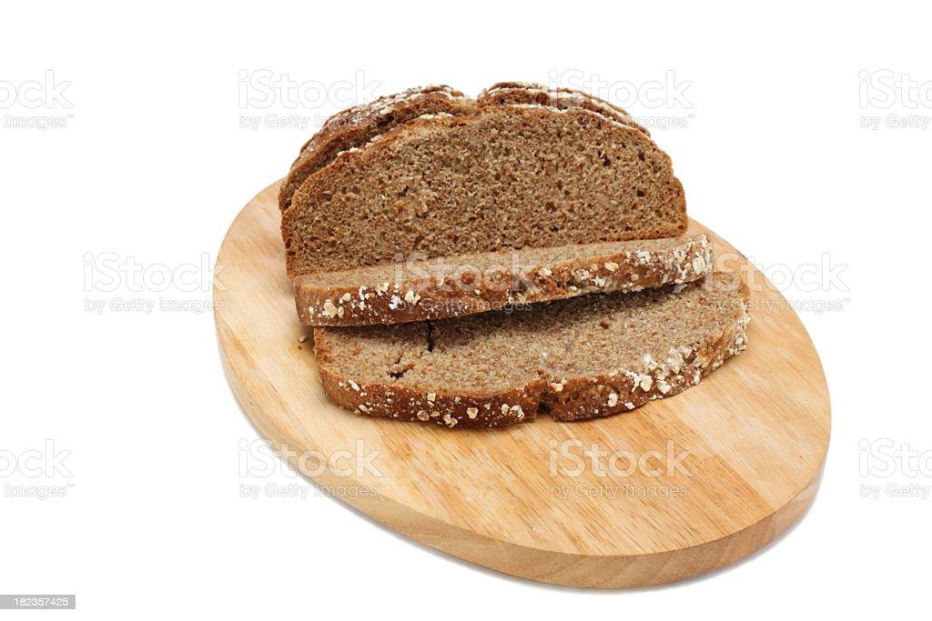 irish wheaten brown soda bread on wooden breadboard stock photo