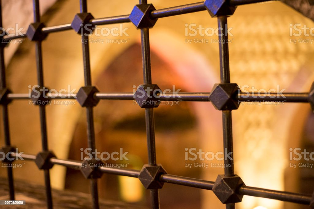 Iron bar fence on a wall of historic mosque in Gaziantep, Turkey stock photo