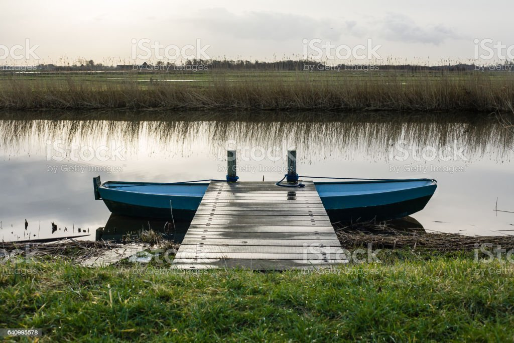 Iron barge at a pier in the polder stock photo