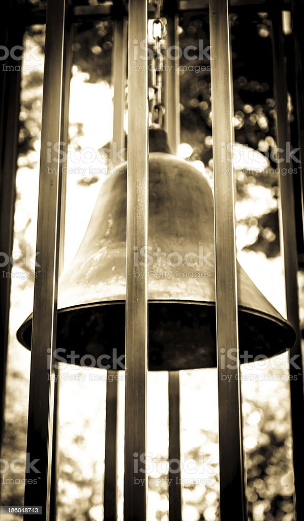 Iron Bell in Bars royalty-free stock photo