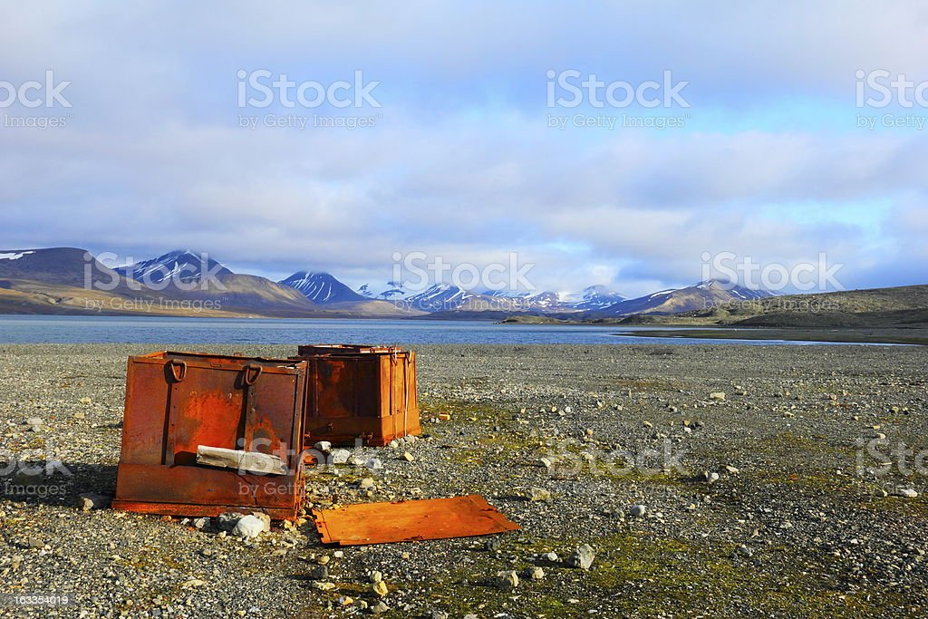 Iron boxes on the beach in Spitsbergen (Svalbard) royalty-free stock photo