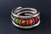 iron bracelet with colored stones isolated on black