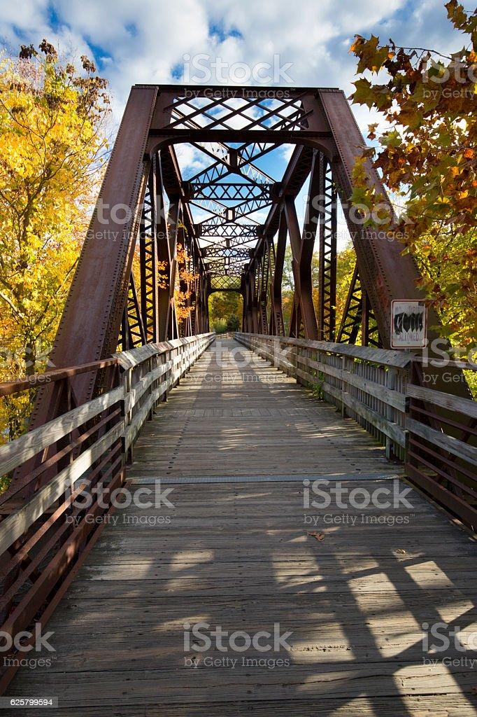 Iron bridge carries the Farmington River Trail in Canton, Connec stock photo