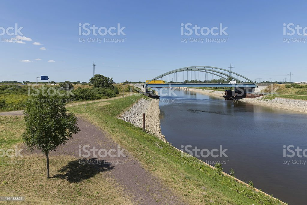Iron bridge is crossing a canal in Germany royalty-free stock photo