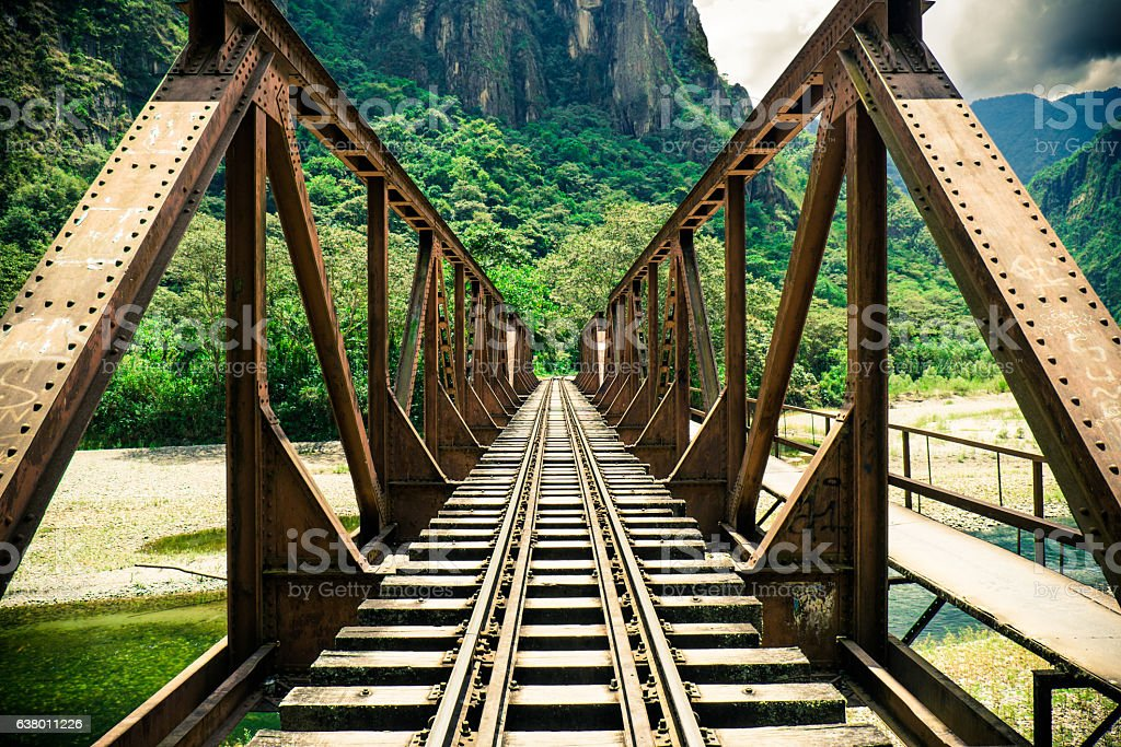 Iron Bridge Passing over a River in the Jungle stock photo