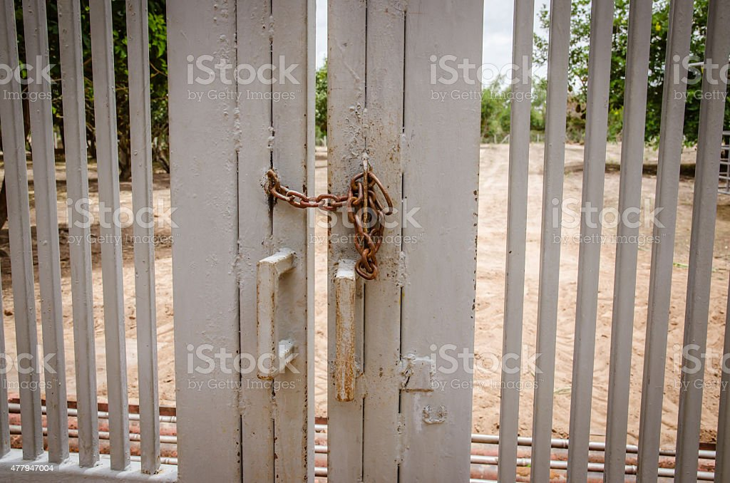 Iron Chain on a barred Double Gate stock photo