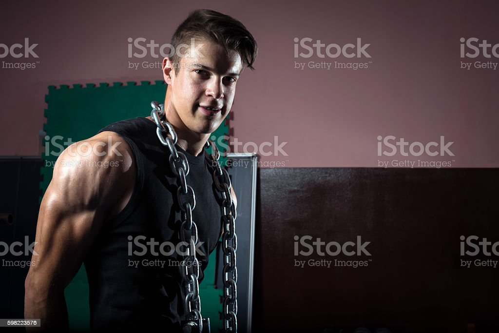 Iron chain on fit man stock photo