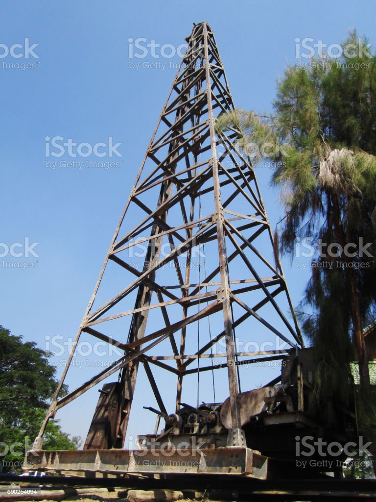 iron construction of pile driver at construction site stock photo