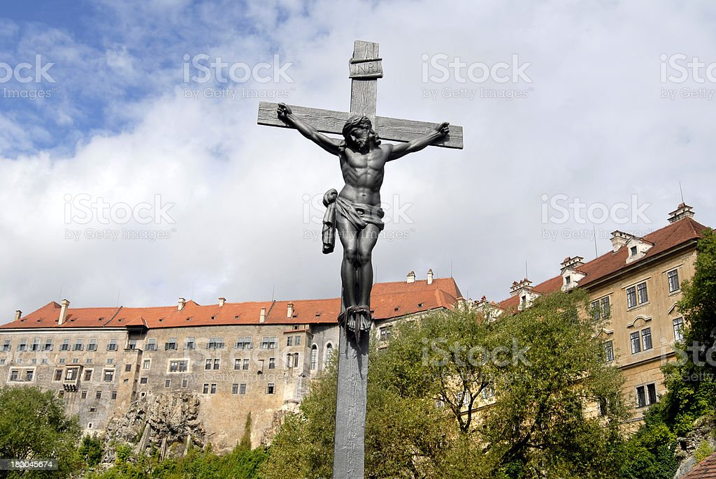 Iron Crucifix in front of Cesky Krumlov castle royalty-free stock photo