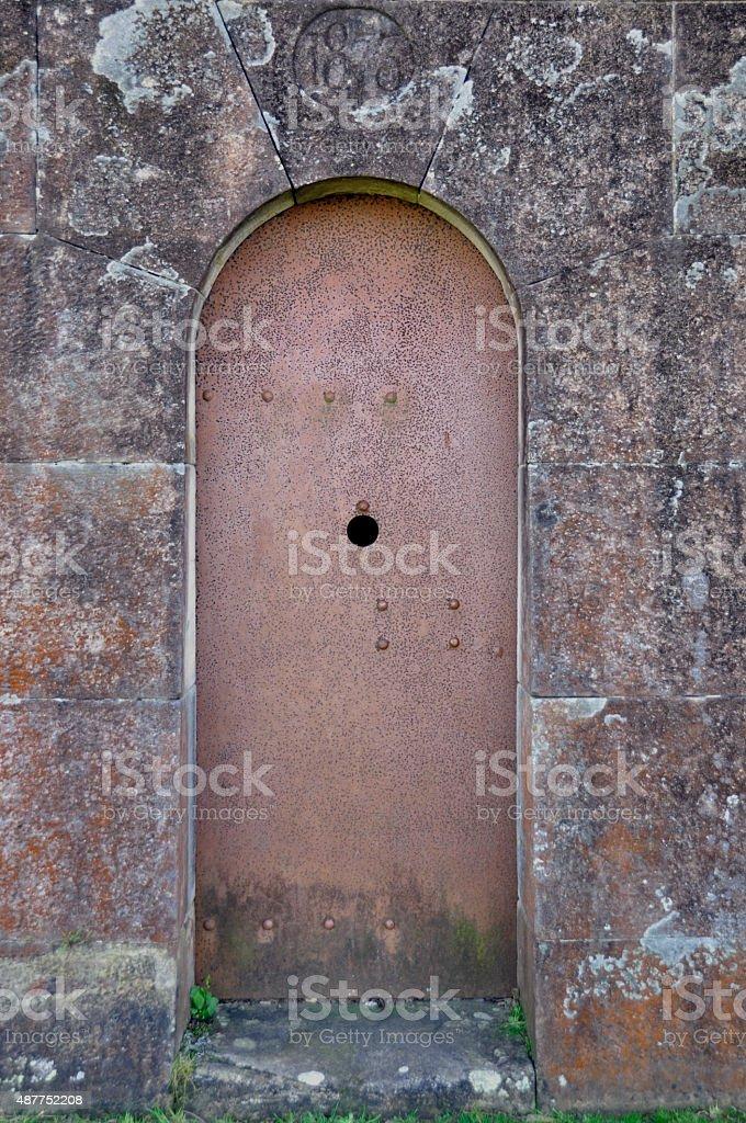Iron Door Rusty Guarding stone Forte stock photo