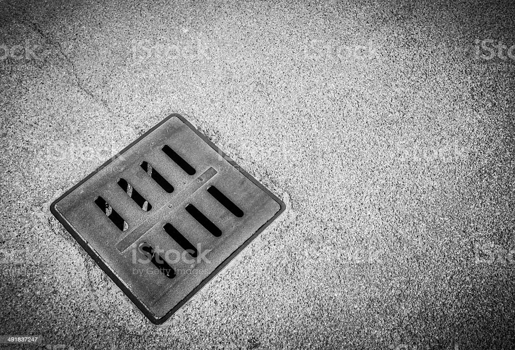 Iron Drain Cover, Black And White royalty-free stock photo