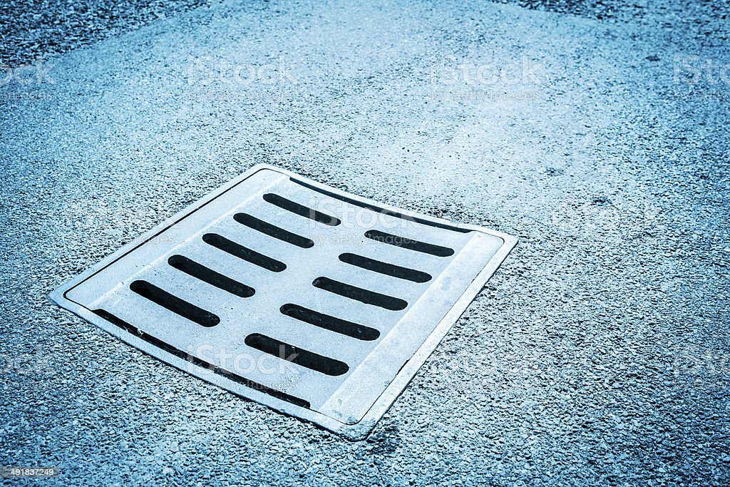 Iron Drain Cover, Blue Toned royalty-free stock photo