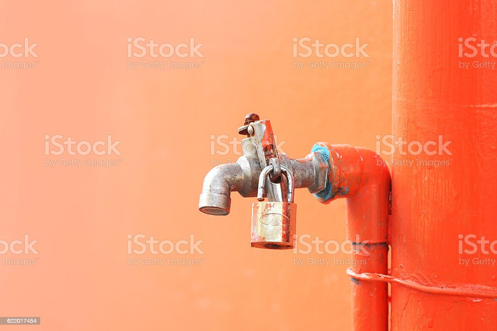 iron faucet water with lock stock photo