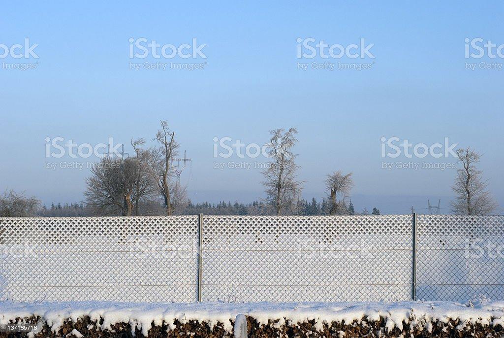 Iron fence and landscape stock photo