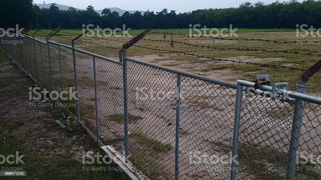 Iron fence with barbed wire stock photo