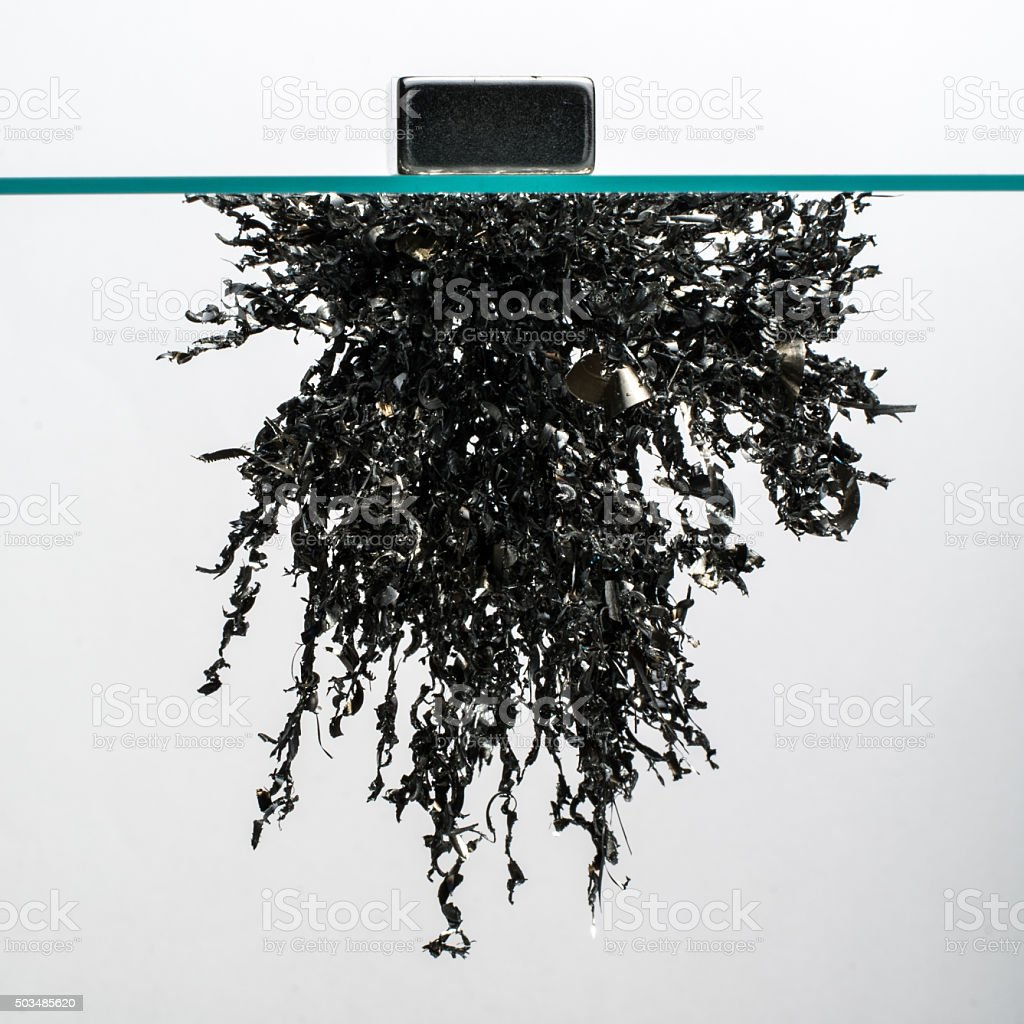 Iron filings in a magnetic field stock photo
