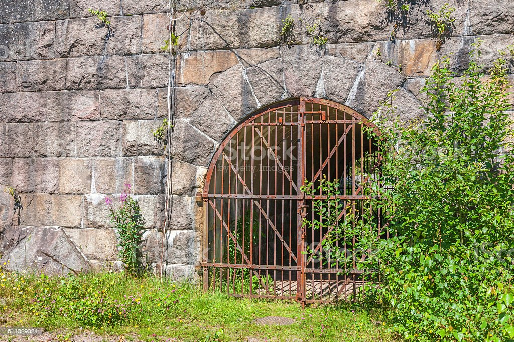 Iron gate in an old stone fortress stock photo