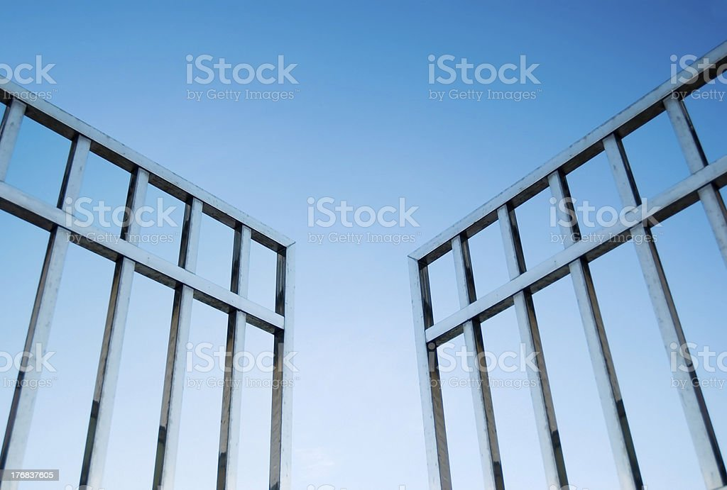 iron gate open to the sky stock photo