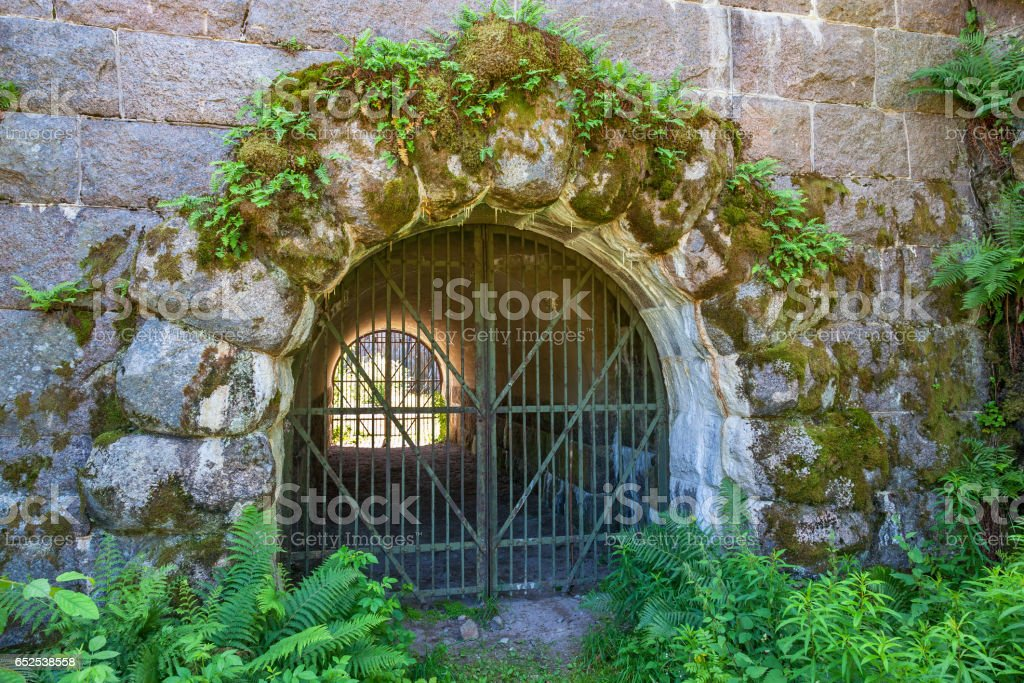 Iron gate with archway to moat into a fortress stock photo