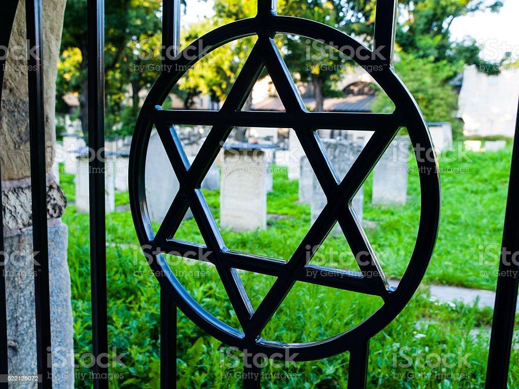 Iron gate with David star at jewish cemetery stock photo