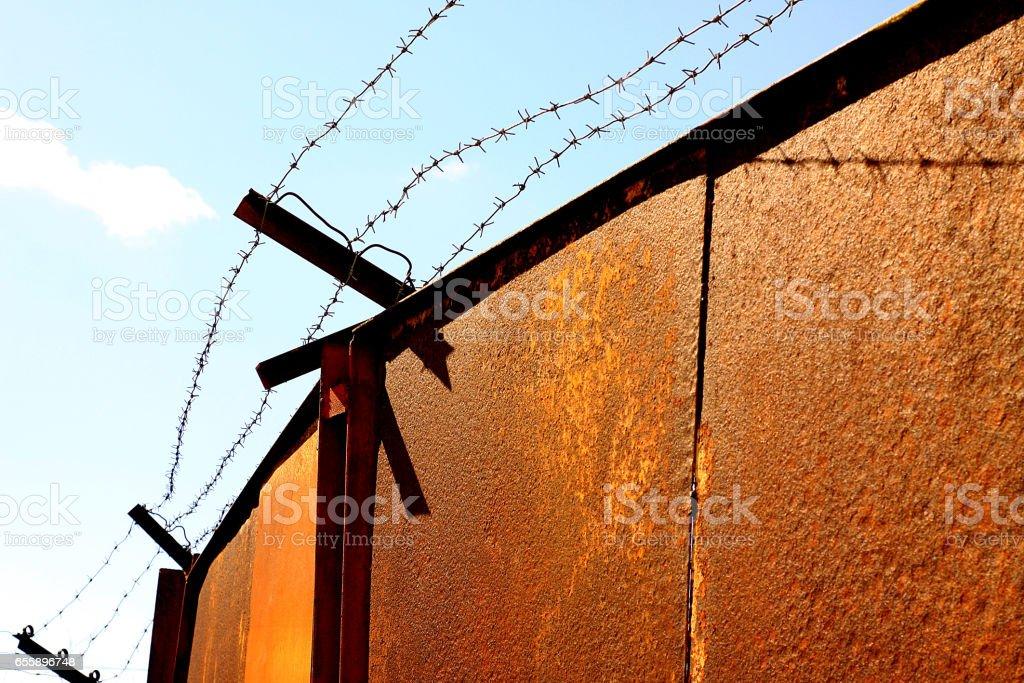 Iron gates in prison stock photo