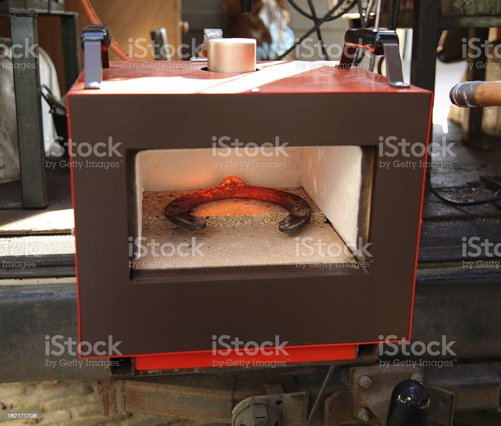 Iron in oven stock photo