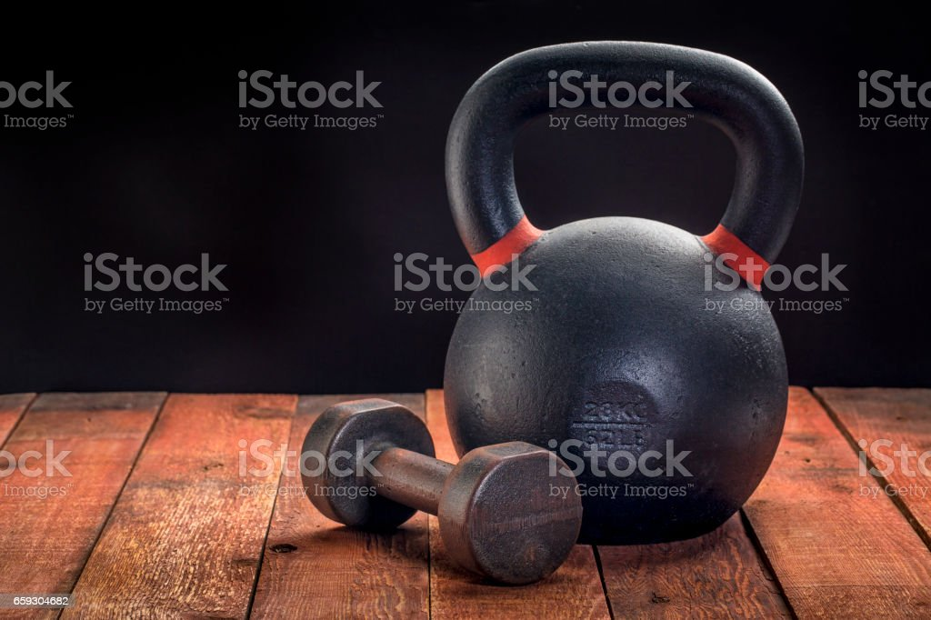 iron kettlebell and dumbbell stock photo