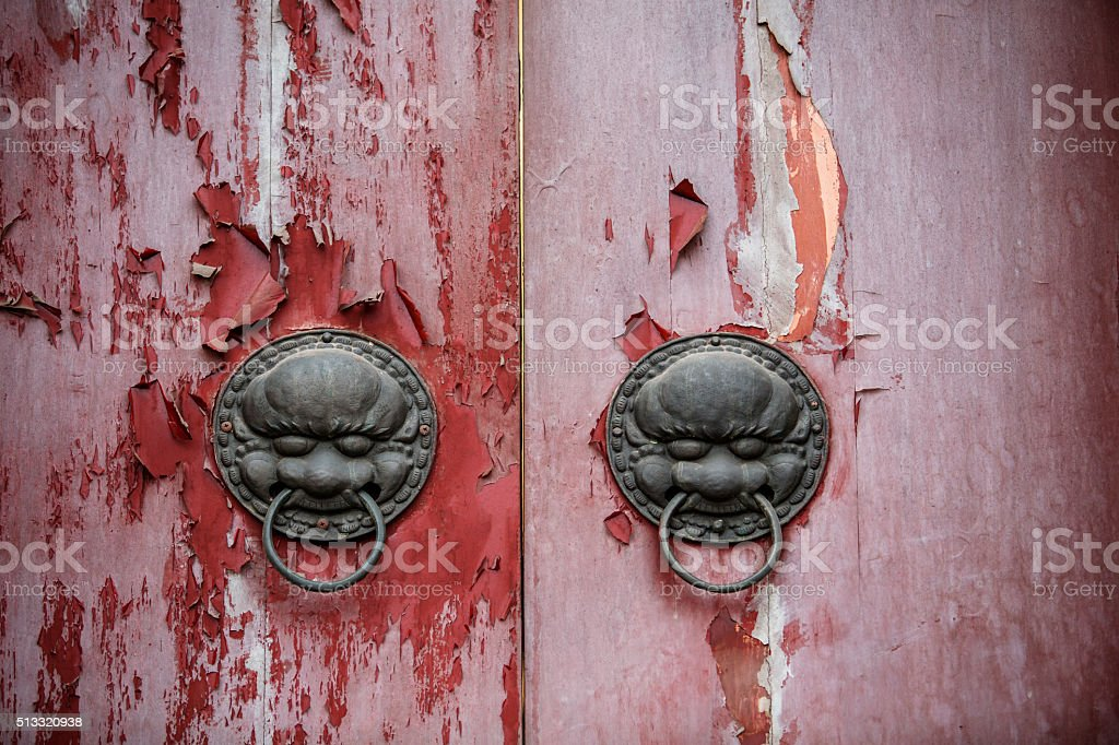 iron lion knocker on old wooden door stock photo