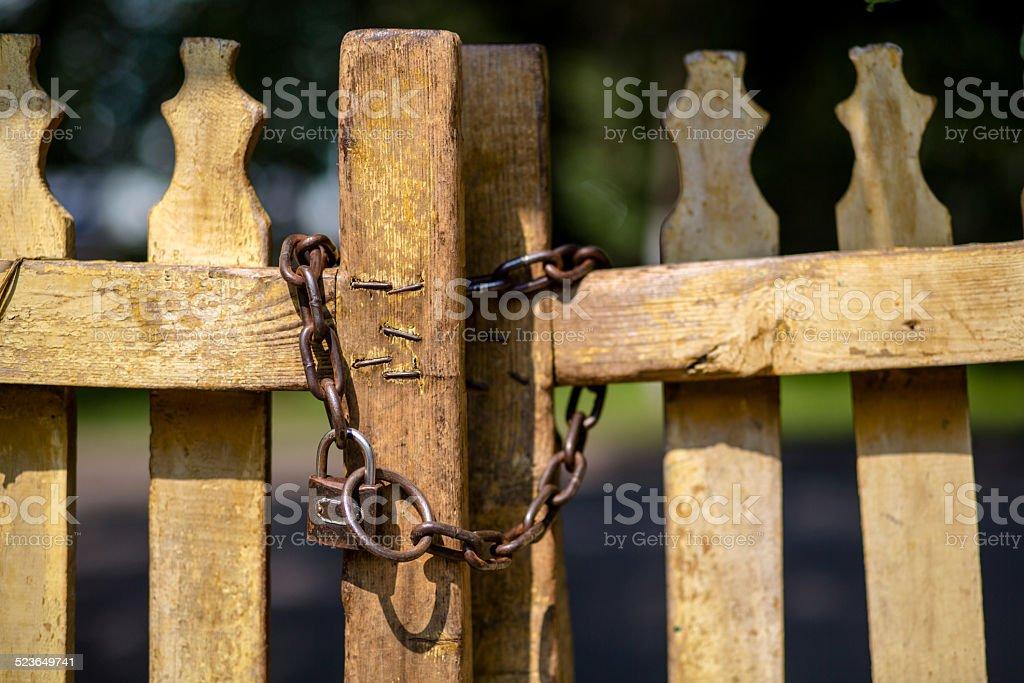 iron lock on wooden fence stock photo