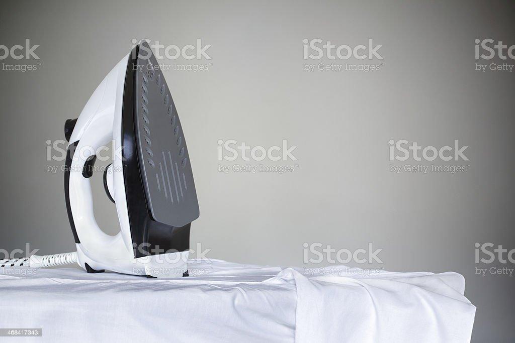 Iron on a shirt stock photo