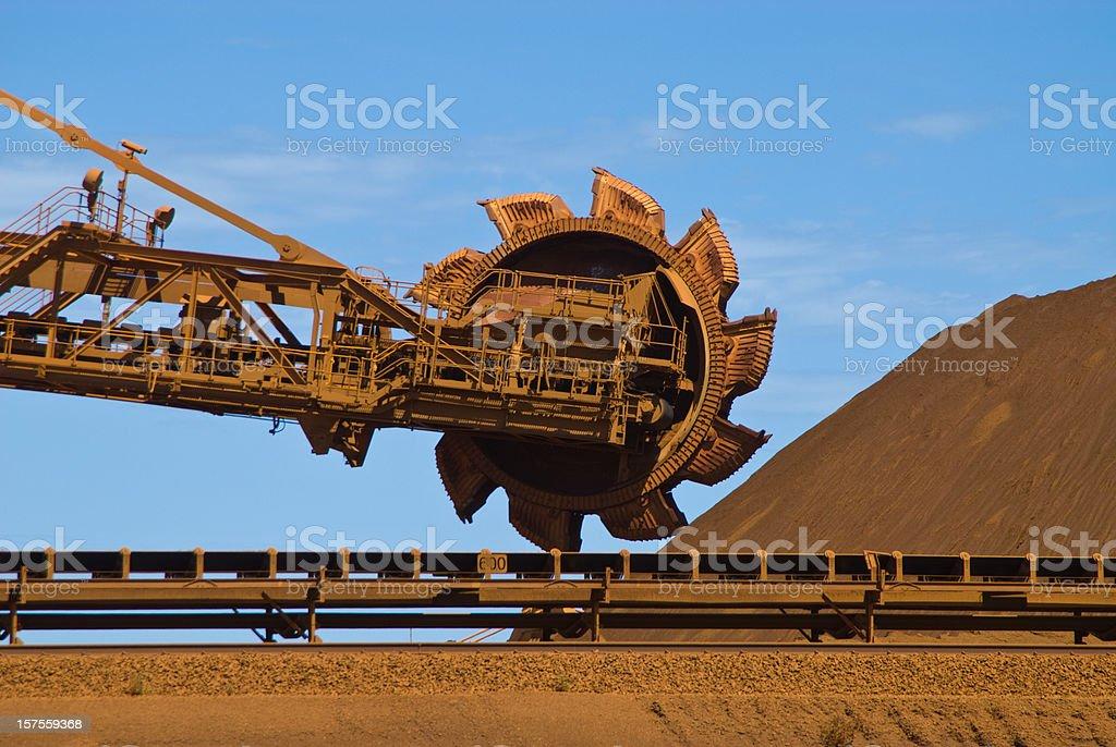 Iron ore mine site with reclaimer running  stock photo