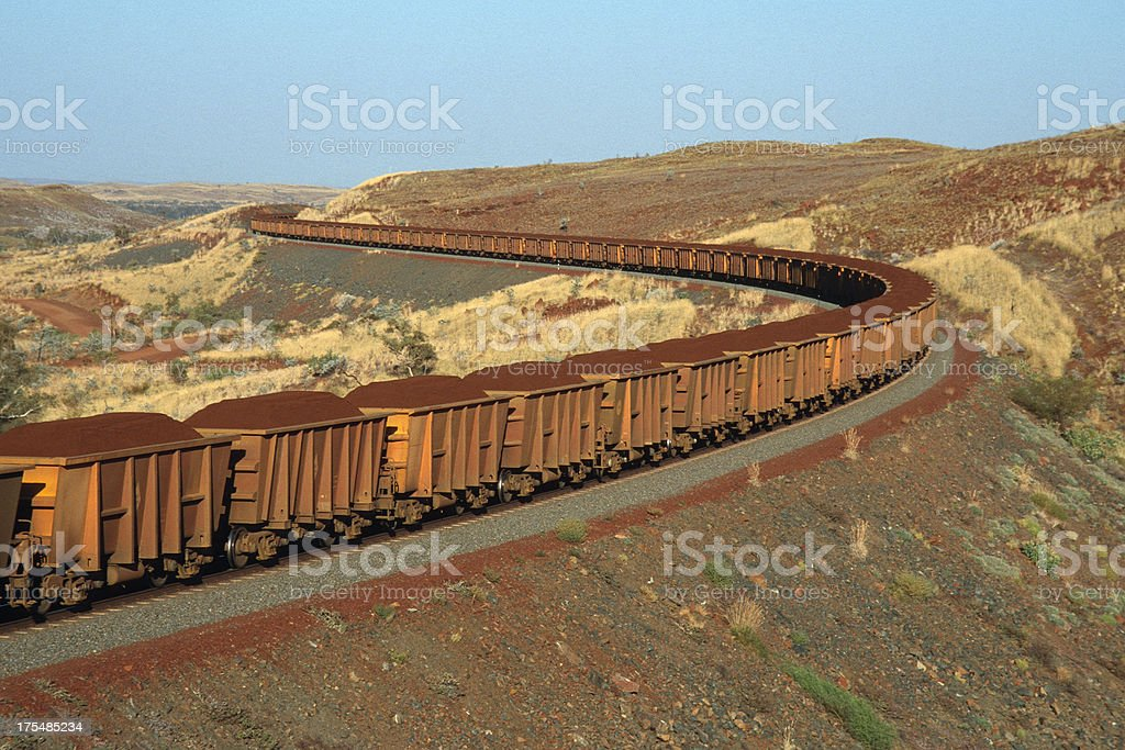 Iron ore on the move from mine to port stock photo