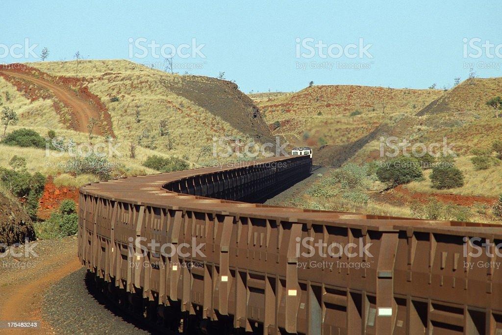 Iron ore train in scenic hills stock photo