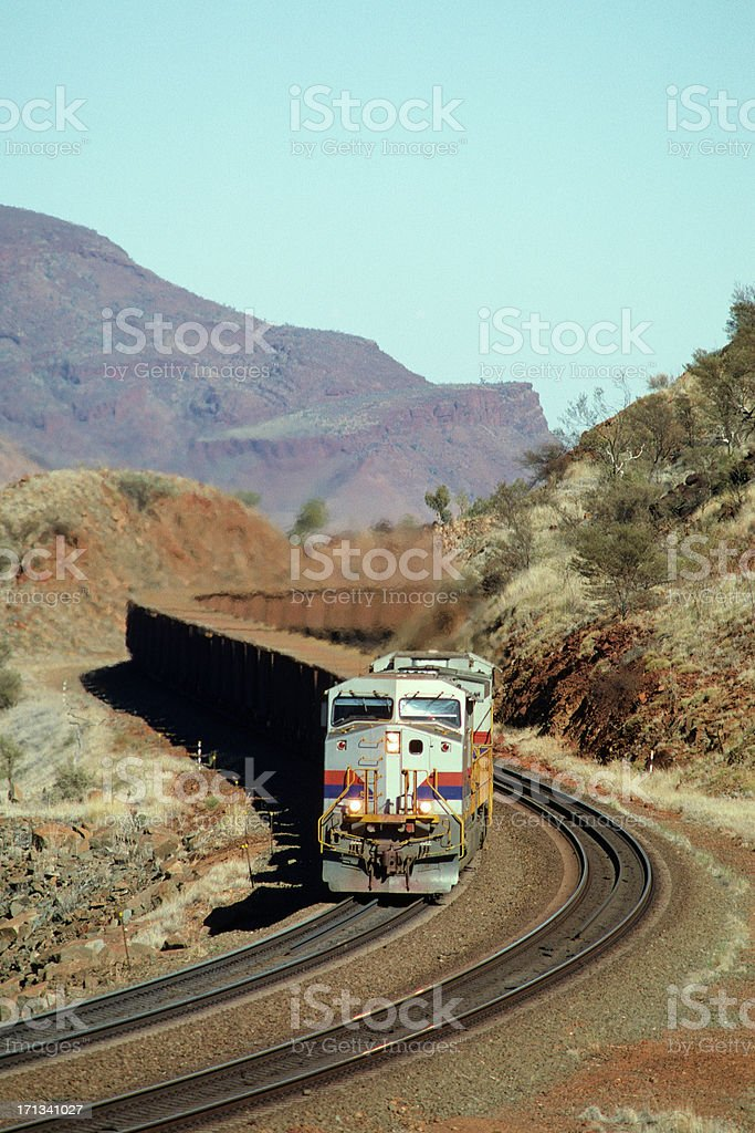 Iron ore train in spectacular hills royalty-free stock photo