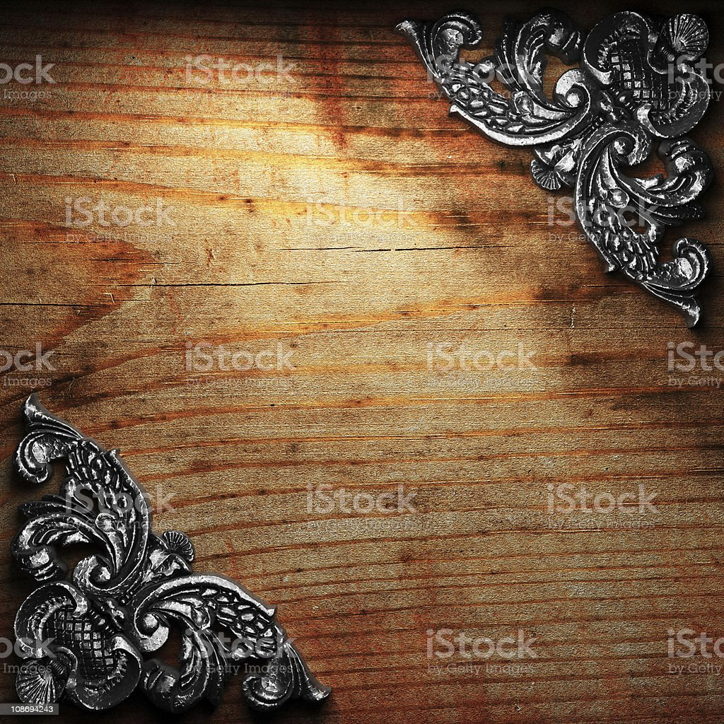 iron ornament on wood royalty-free stock photo
