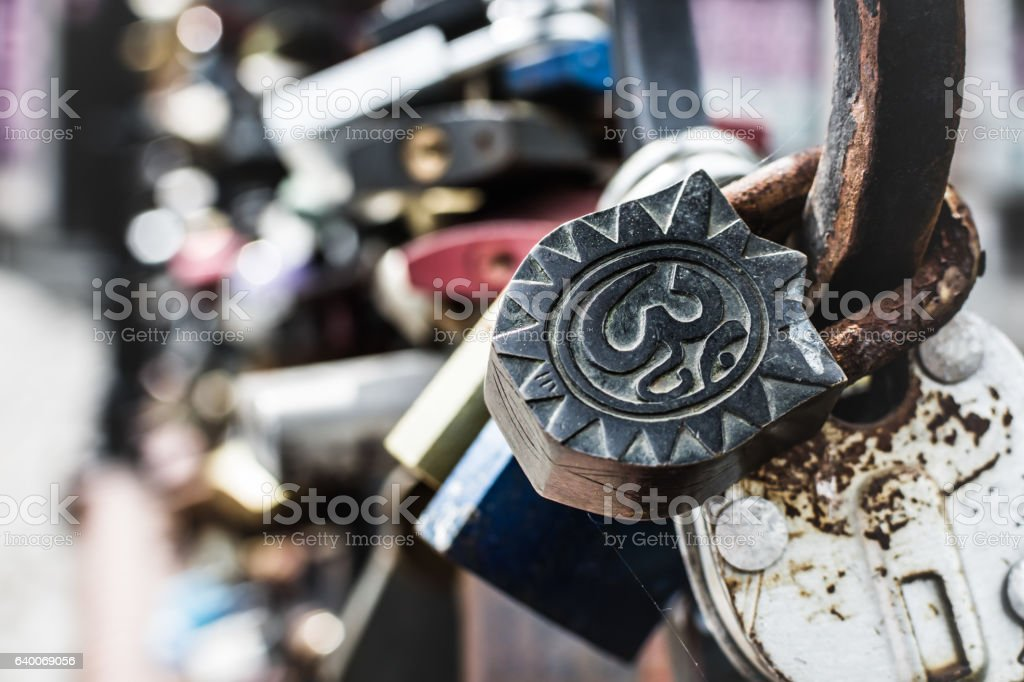 Iron padlock with om (aum) symbol. stock photo