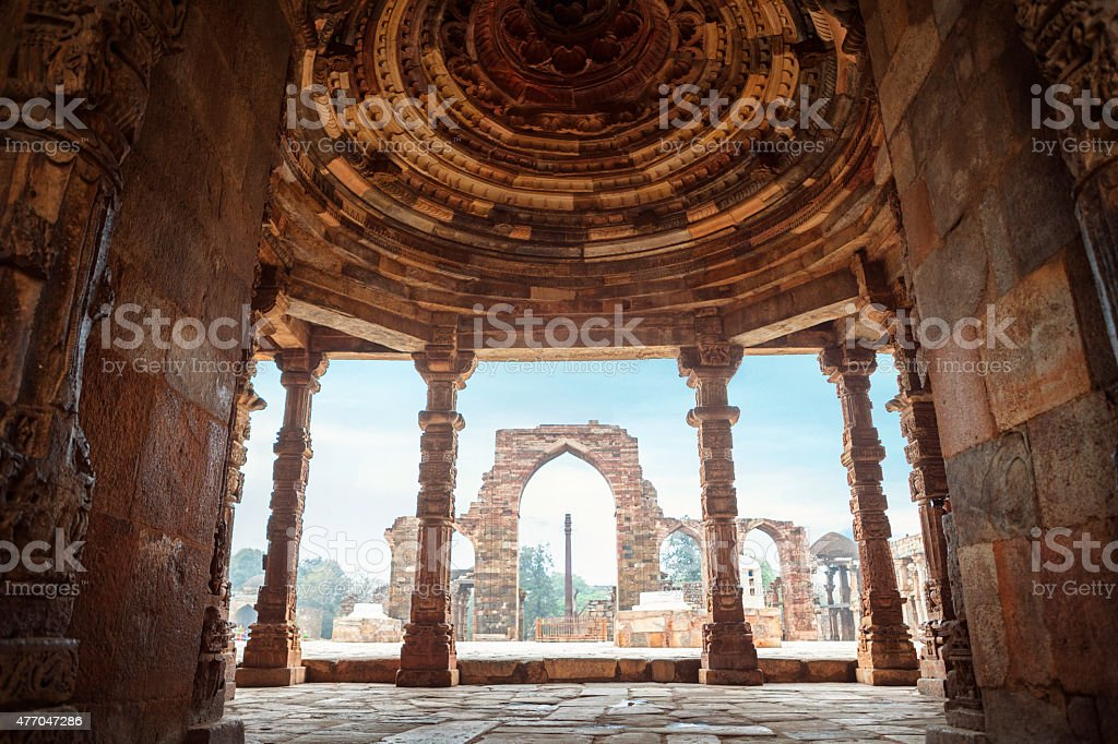 Iron Pillar at Quwwat ul-Islam Mosque in Qutb Complex, India stock photo