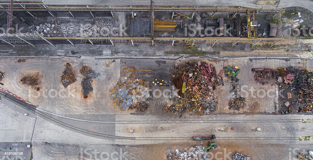 Iron raw materials recycling pile, work machines. Metal waste ju stock photo