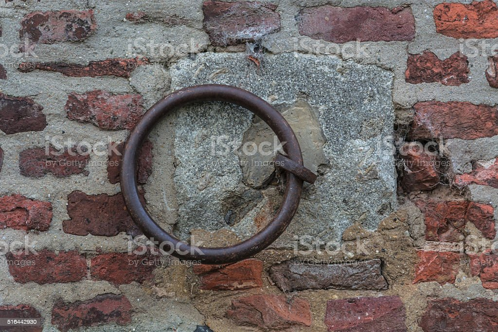 Iron ring on a wall stock photo