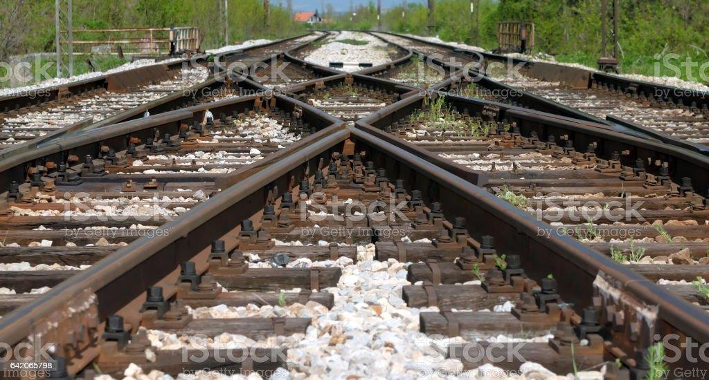 Iron rusty train railway detail over dark stones stock photo
