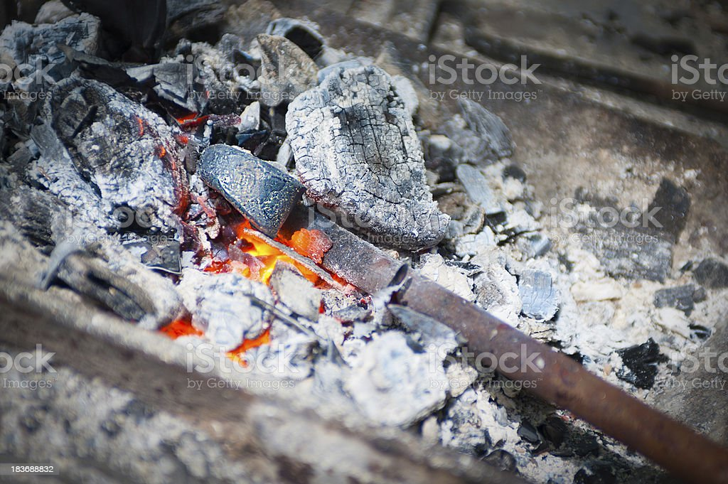 Iron stick in glowing ember furnace stock photo